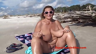 Huge saggy tits on the shore