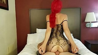 Redhead rides cock in lingerie